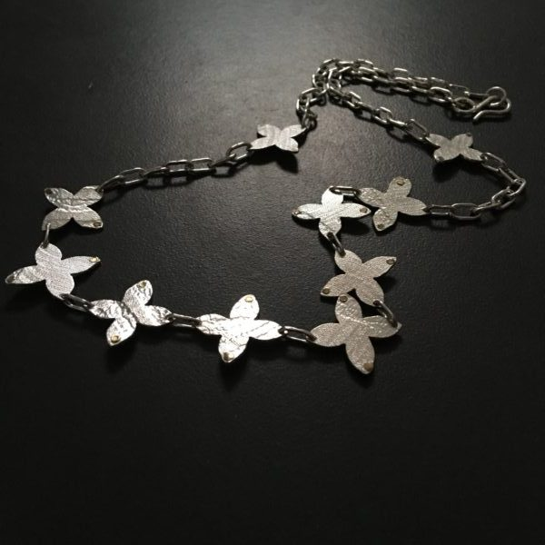 Necklace of Cascading Flower Stars handmade in Sterling Silver